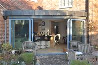 300 year old, Grade 2 listed dwelling adds a stunning contemporary twist with Curved Patio Doors supplied by Balcony Systems.