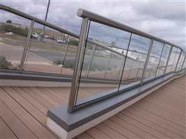Long balustrade with clear glass and Royal Chrome handrails and posts