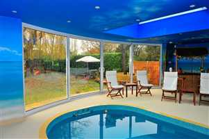 4 Curved Glass Sliding Doors in pool room