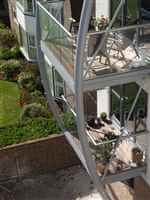 curved steel balcony structure with royal chrome balustrades
