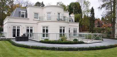 Wide Silver curved balustrades and Juliet balcony on beautiful white house
