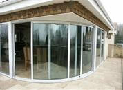 A three pane Curved Patio Door, Tinted Glass Balustrades on a large terrace and a Juliet balcony in this luxury five-bedroomed house.