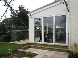 Glass Balcony semi-frameless with white handrail