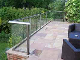 Royal Chrome balustrade on a tiled patio in a pretty garden