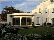 Curved Glass Sliding Doors supplied by Balcony Systems transforms B&B on the South Coast