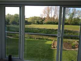 Glass Juliet Balcony looking our from kitchen in Berkshire