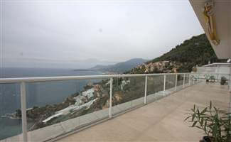 White balustrade with beautiful views down the mountain to the sea