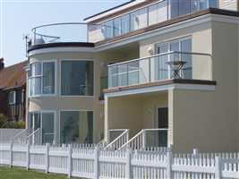 Recidency on the coast with Silver balustrades with a white picket fence