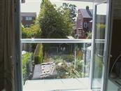 Self-Cleaning Glass Juliet Balcony reduces the maintenance for couple in Sheffield.
