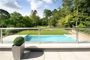Royal Chrome balustrade looking over swimming pool and beautiful grounds
