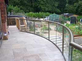 Bronze balcony 1 curved balustrade with stairs and gardens