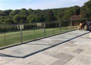 Glass was the balustrading material of choice for this large renovated patio at an East Sussex home that enjoys spectacular unspoilt views across adjoining countryside.