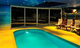 Pool room at night with 4 sliding doors