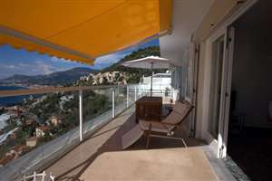 White balustrade with an amazing view and awning