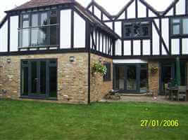 Tudor style house with Royal Chrome Juliet balcony