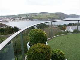 Curved Royal Chrome balcony with a beautiful Isle of Man view