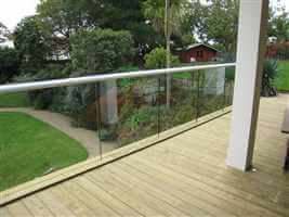 structural glass balcony with white handrail