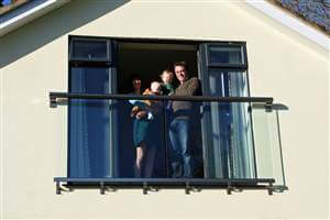 Family standing by their Royal Chrome Juliet balcony