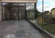 Elegant frameless glass balustrade, supplied and installed by Balcony Systems. Low-maintenance frameless balustrading uses nearly eight m of 21.5mm toughened laminated glass.