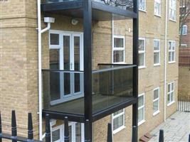 glass balconies on a metal structure bristol
