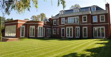 Curved balcony and straight balcony on a beautiful house set in lovely grounds