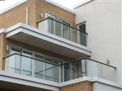 13-apartment building in Wimbledon, London is complemented perfectly by Balcony Sytems' Glass Balustrades and Juliet Balconies.