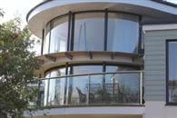 Curved Glass Sliding Door and Curved Glass Balustrade adds light to South Devon Coast home