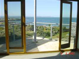 Looking out over the sea through clear glass, white balustrade