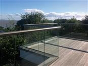 Decking glass balustrade is the best for your decking. The view is better than with a traditional iron or wooden balustrading. Why Balcony Systems decking balustrades?