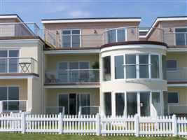 Silver balustrading and Juliet balcony on recidence with white picket fence