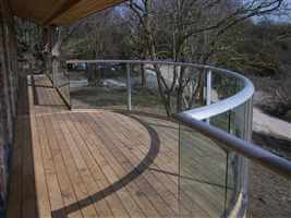 Silver curved aerofoil balcony with dry land view