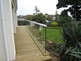 Semi frameless white balcony