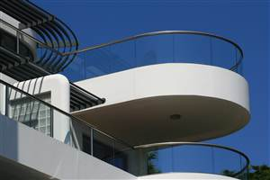 Curved and semi-frameless Royal Chrome balustrading with blue skies