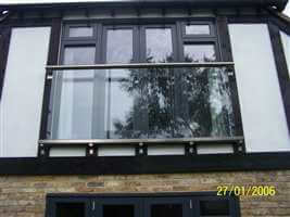 Tudor style house with large Royal Chrome Juliet balcony