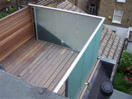 Small box balcony with silver handrails and tinted glass