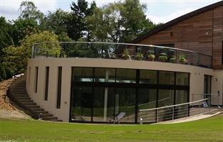 curved patio doors and glass balustrade
