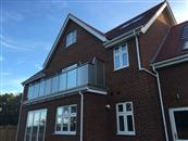 Surrey-based Woldingham Homes have built five luxury detached houses with Glass Balustrades supplied and installed by Balconette.