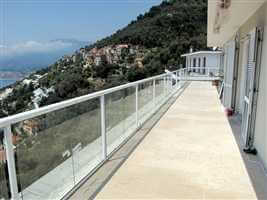 Long white balustrade on the mountain top with beautiful views and blue skies