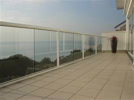 White balustrading to match a beautiful white house on the mountains