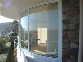 Curved glass Slidiing Windows