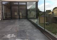 Every Balconette Frameless Glass balustrade is supported by a combination of anodised aluminium base shoe and laminated glass. The system is recessed below the floor but these glass railings are fully supported.