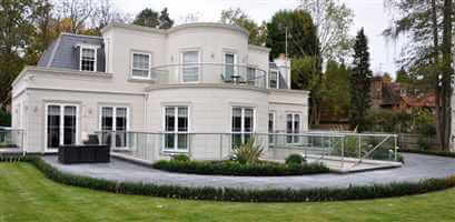 Grand white house with silver balustrading and Juliet balconies