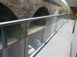 Large balustrade with Royal Chrome handrail over looking brick arches