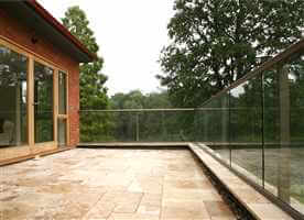 Bronze clear glass balcony surrounded by trees