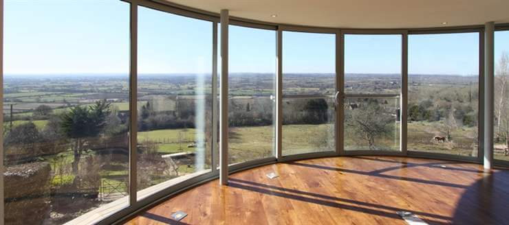 Curved Sliding Doors showing off a stunning view
