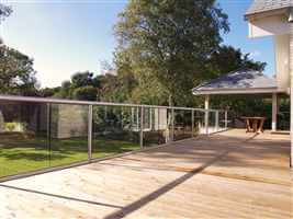 Long stretch of beautiful balustrading with silver posts and handrails and a lovely countryside view