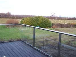 Royal Chrome balustrade looking out onto fields and sheep