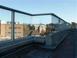 Silver handrail balustrade looking onto urban landscape