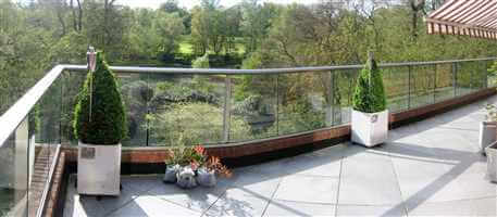 Panorama of a Royal Chrome balustrade over looking gardens