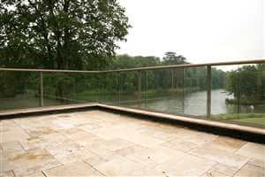 View through Bronze clear glass balcony to a lake